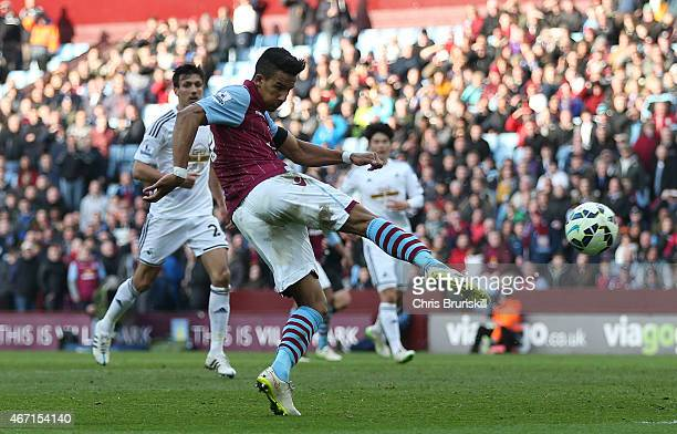 Scott Sinclair of Aston Villa shoots at goal during the Barclays Premier League match between Aston Villa and Swansea City at Villa Park on March 21...
