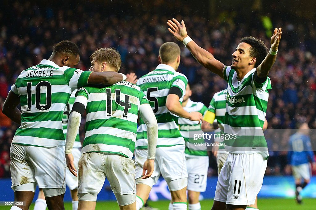 Scott Sinclair (R) of Celtic celebrates scoring his team's second goal during the Ladbrokes Scottish Premiership match between Rangers and Celtic at Ibrox Stadium on December 31, 2016 in Glasgow, Scotland.