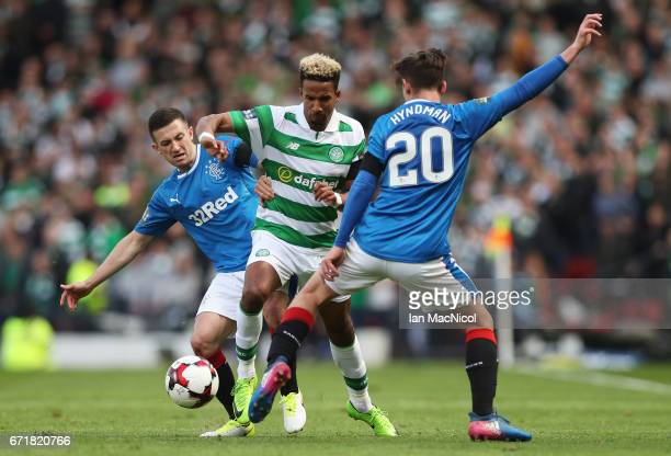 Scott Sinclair of Celtic competes for the ball against Jason Holt and Emerson Hyndman of Rangers during the Scottish Cup SemiFinal match between...