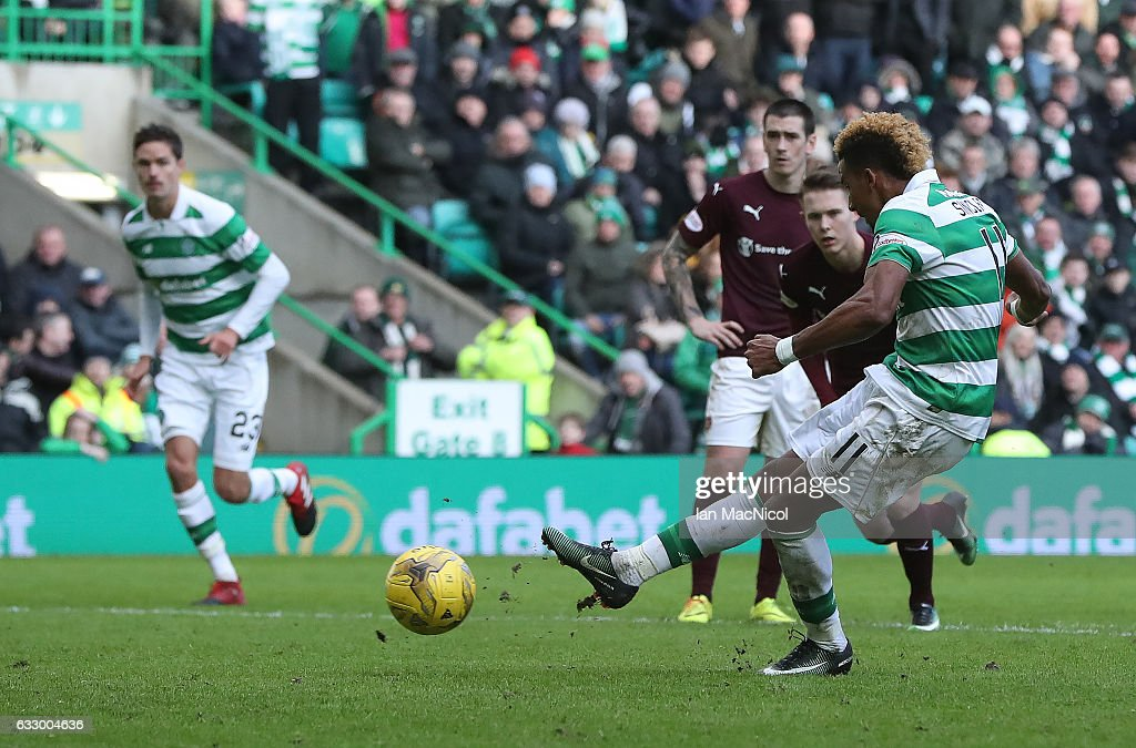 Scott Sinclair of Celtic scores his team's fourth goal from the penalty spot during the Ladbrokes Scottish Premiership match between Celtic and Heart of Midlothian at Celtic Park Stadium on January 29, 2017 in Glasgow, Scotland.