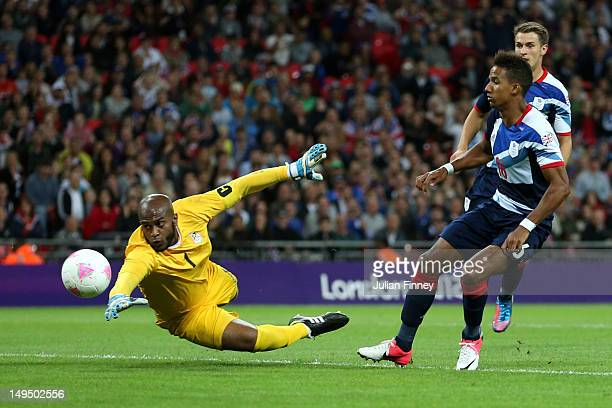 Scott Sinclair of Great Britain scores a goal during the Men's Football first round Group A Match between Great Britain and United Arab Emirates on...