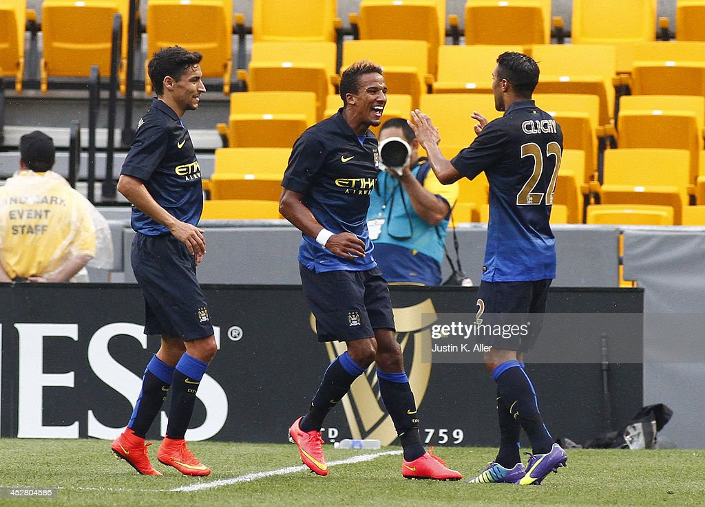 <a gi-track='captionPersonalityLinkClicked' href=/galleries/search?phrase=Scott+Sinclair+-+Soccer+Player&family=editorial&specificpeople=4158957 ng-click='$event.stopPropagation()'>Scott Sinclair</a> #12 of Manchester City celebrates with teammates after scoring in the first half against AC Milan during International Champions Cup 2014 at Heinz Field on July 27, 2014 in Pittsburgh, Pennsylvania.