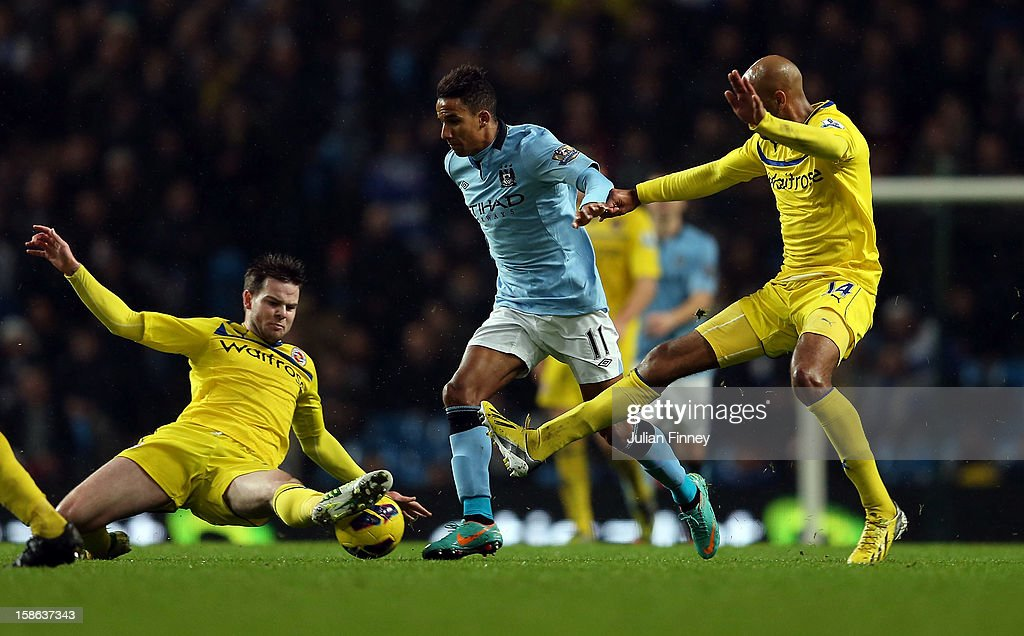 <a gi-track='captionPersonalityLinkClicked' href=/galleries/search?phrase=Scott+Sinclair&family=editorial&specificpeople=4158957 ng-click='$event.stopPropagation()'>Scott Sinclair</a> of Manchester City is tackled by <a gi-track='captionPersonalityLinkClicked' href=/galleries/search?phrase=Danny+Guthrie&family=editorial&specificpeople=747593 ng-click='$event.stopPropagation()'>Danny Guthrie</a> of Reading (L) and <a gi-track='captionPersonalityLinkClicked' href=/galleries/search?phrase=Jimmy+Kebe&family=editorial&specificpeople=2953929 ng-click='$event.stopPropagation()'>Jimmy Kebe</a> of Reading during the Barclays Premier League match between Manchester City and Reading at Etihad Stadium on December 22, 2012 in Manchester, England.