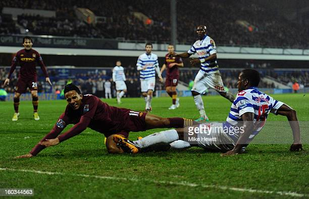 Scott Sinclair of Manchester City is tackled by Nedum Onuoha of QPR during the Barclays Premier League match between Queens Park Rangers and...