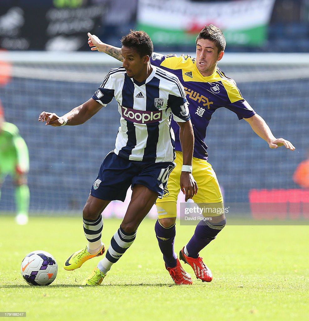 Scott Sinclair of West Browmich moves away from Pablo Hernandez during the Barclays Premier League match between West Bromwich Albion and Swansea City at The Hawthorns on September 01, 2013 in West Bromwich, England.