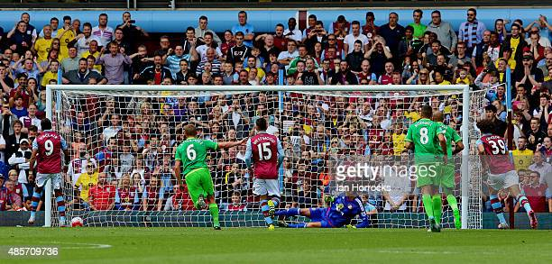 Scott Sinclair scores the first goal for Aston Villa from the penalty spot during the Barclays Premier League match between Aston Villa and...