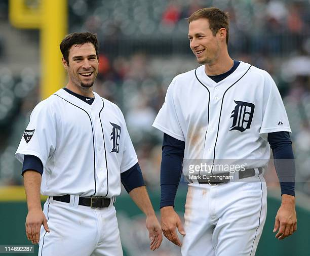 Scott Sizemore and Don Kelly of the Detroit Tigers look on and smile against the Tampa Bay Rays during the game at Comerica Park on May 25 2011 in...