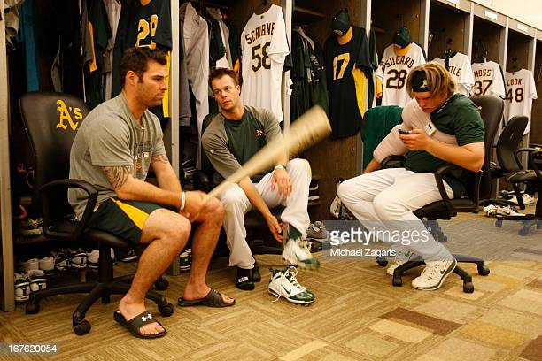 Scott Sizemore Evan Scribner and AJ Griffin of the Oakland Athletics relax in the clubhouse prior to the game against the Detroit Tigers at Oco...