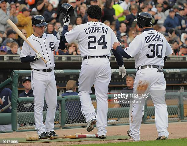 Scott Sizemore of the Detroit Tigers congratulates teammates Miguel Cabrera and Magglio Ordonez during the game against the New York Yankees at...