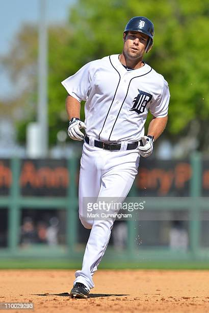 Scott Sizemore of the Detroit Tigers runs the bases against the Toronto Blue Jays during the spring training game at Joker Marchant Stadium on March...