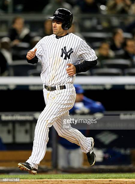 Scott Sizemore of the New York Yankees scores a run in the fourth inning against the Chicago Cubs during game two of a doubleheader on April 16 2014...