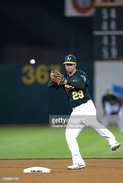 Scott Sizemore of the Oakland Athletics can't handle the ball hit up the middle against the Seattle Mariners in the eighth inning at Oco Coliseum on...