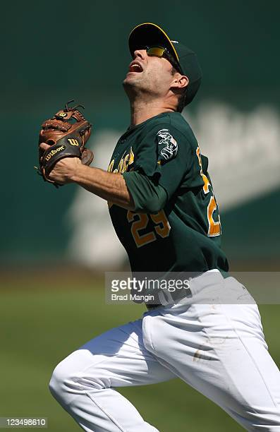 Scott Sizemore of the Oakland Athletics chases a foul ball against the Seattle Mariners during the game at Oco Coliseum on September 3 2011 in...