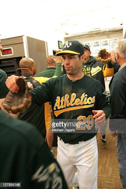 Scott Sizemore of the Oakland Athletics is congratulated in the clubhouse following the game against the Detroit Tigers at the OaklandAlameda County...
