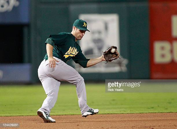 Scott Sizemore of the Oakland Athletics stops a hit by Adrian Beltre of the Texas Rangers at Rangers Ballpark in Arlington on September 9 2011 in...