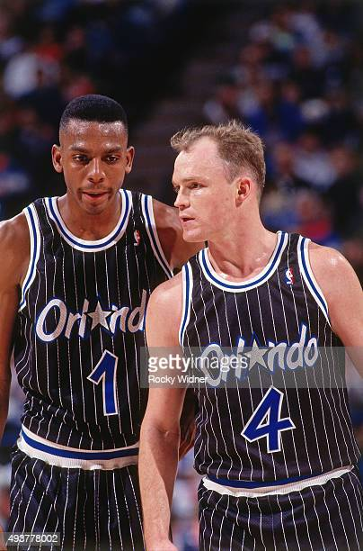 Scott Skiles and Anfernee Hardaway of the Orlando Magic look on against the Sacramento Kings on December 19 1993 at Arco Arena in Sacramento...