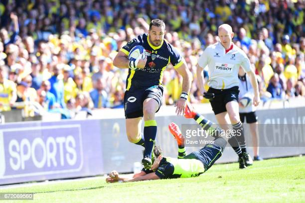 Scott Spedding of Clermont beats Joey Carbery of Leinster during the European Champions Cup semi final match between AS Clermont and Leinster on...