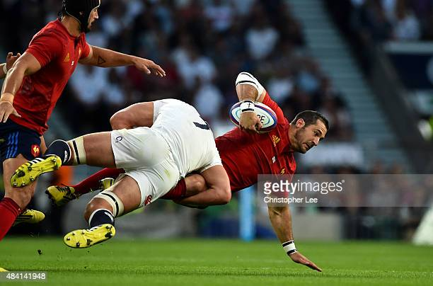 Scott Spedding of France is tackled by Calum Clark of England during the QBE International match between England and France at Twickenham Stadium on...
