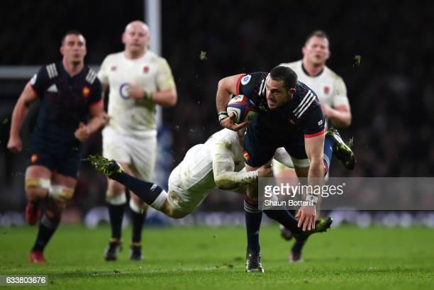 Scott Spedding of France is tackled by Elliot Daly of England during the RBS Six Nations match between England and France at Twickenham Stadium on...