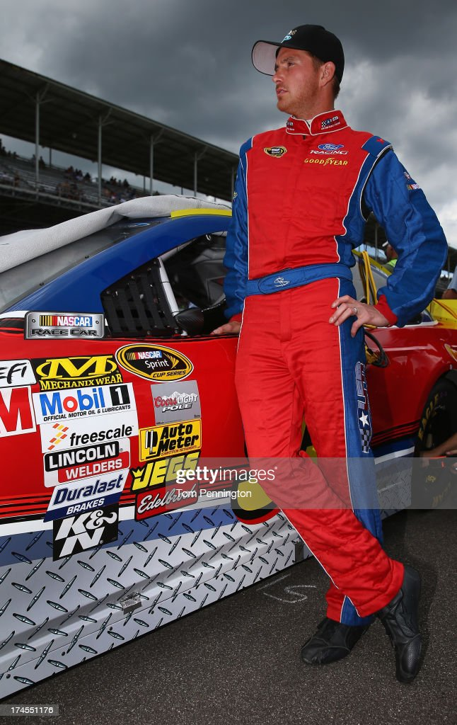 Scott Speed, driver of the #95 Leavine Family Racing Ford, stands on the grid during qualifying for the NASCAR Sprint Cup Series Samuel Deeds 400 At The Brickyard at Indianapolis Motor Speedway on July 27, 2013 in Indianapolis, Indiana.