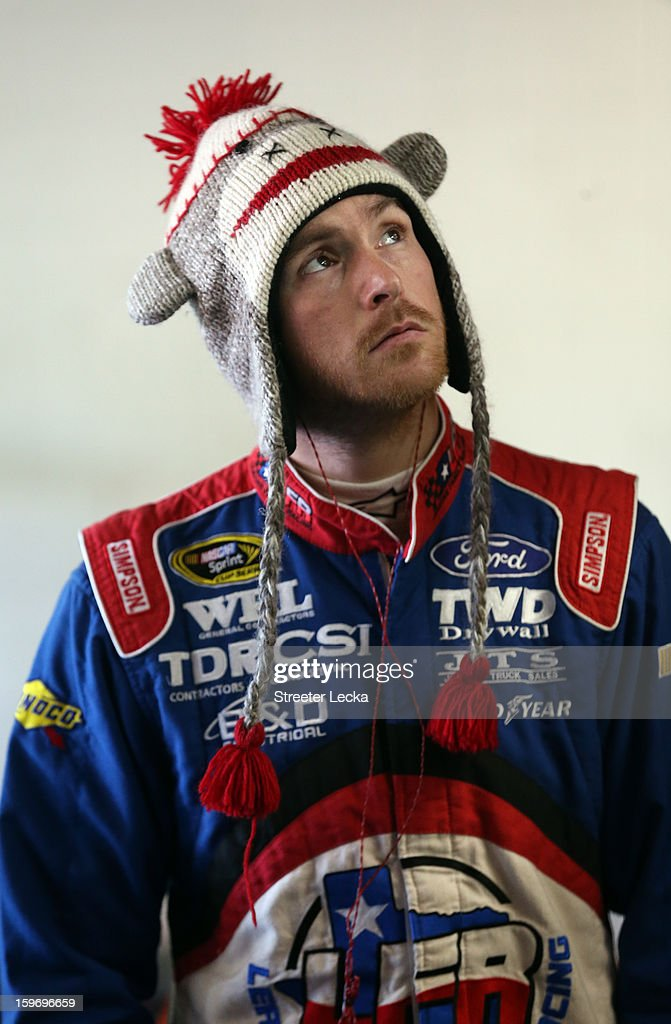Scott Speed, driver of the #99 Leavine Family Racing, watches a screen during NASCAR Testing at Charlotte Motor Speedway on January 18, 2013 in Charlotte, North Carolina.