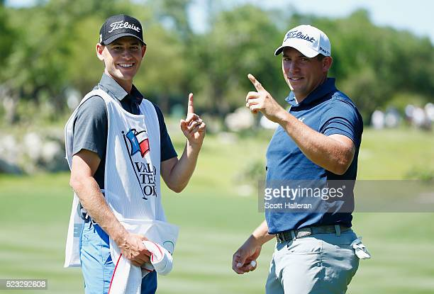 Scott Stallings and his caddie Jay Haas Jr pose after Stallings had a holeinone on the 13th hole during the second round of the Valero Texas Open at...
