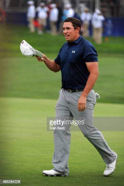 Scott Stallings celebrates on the 18th green during the final round of the Farmers Insurance Open at Torrey Pines Golf Course on January 26 2014 in...
