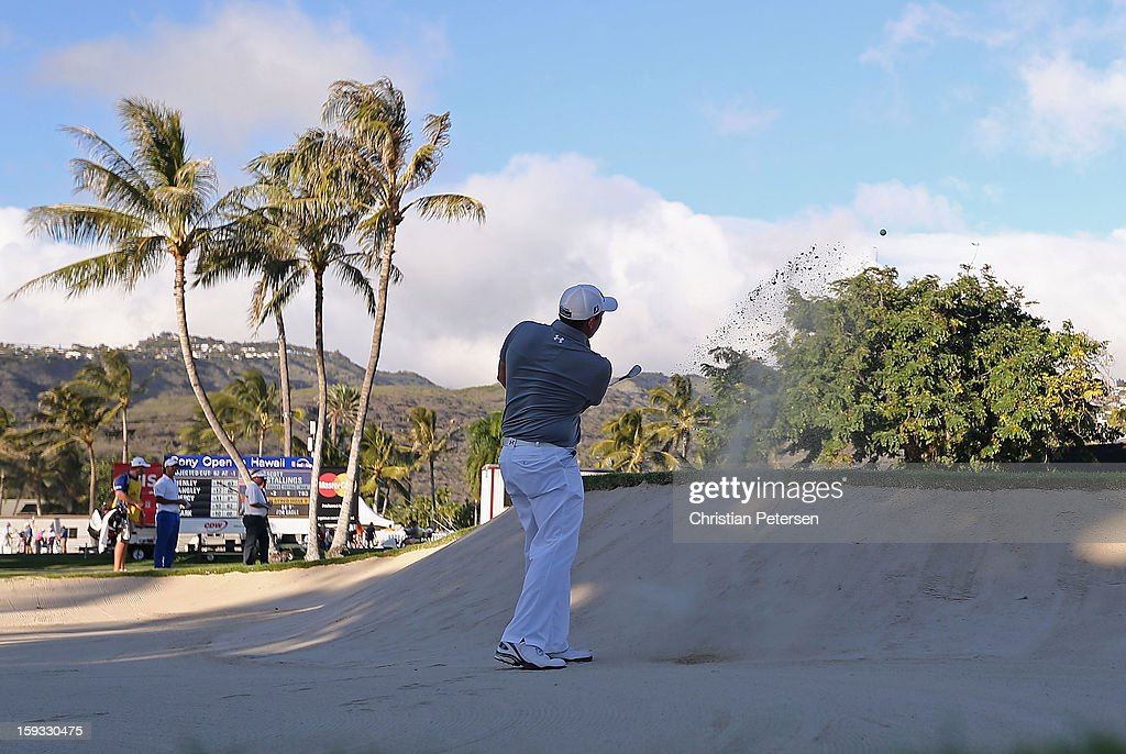 Scott Stallings chips from the bunker onto the ninth hole green during the second round of the Sony Open in Hawaii at Waialae Country Club on January 11, 2013 in Honolulu, Hawaii.