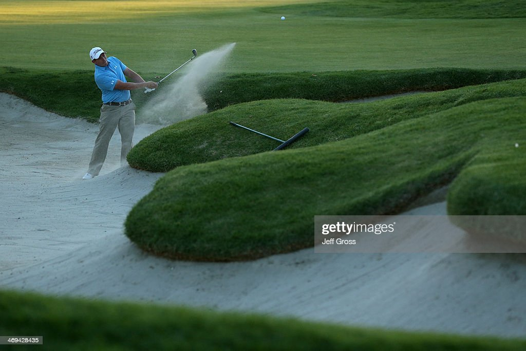 Scott Stallings hits a bunker shot on to the 17th green in the second round of the Northern Trust Open at the Riviera Country Club on February 14...