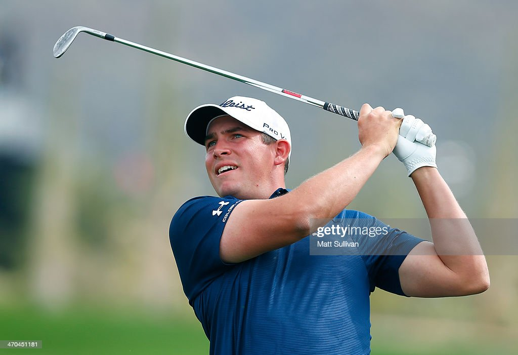 Scott Stallings hits his second shot on the first hole during the first round of the World Golf Championships - Accenture Match Play Championship at The Golf Club at Dove Mountain on February 19, 2014 in Marana, Arizona.