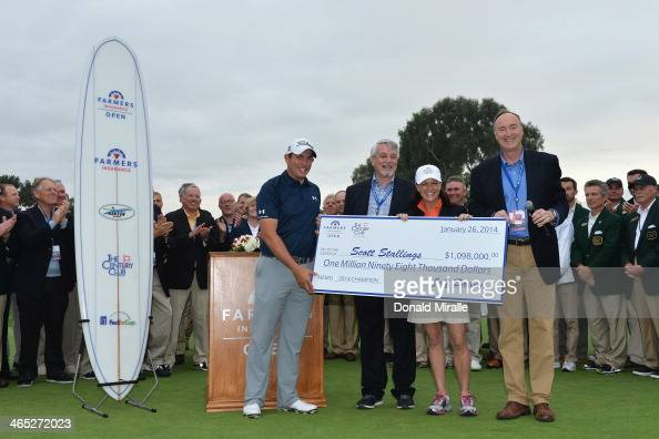 Scott Stallings is presented with a check after winning the Farmers Insurance Open on Torrey Pines South on January 26 2014 in La Jolla California