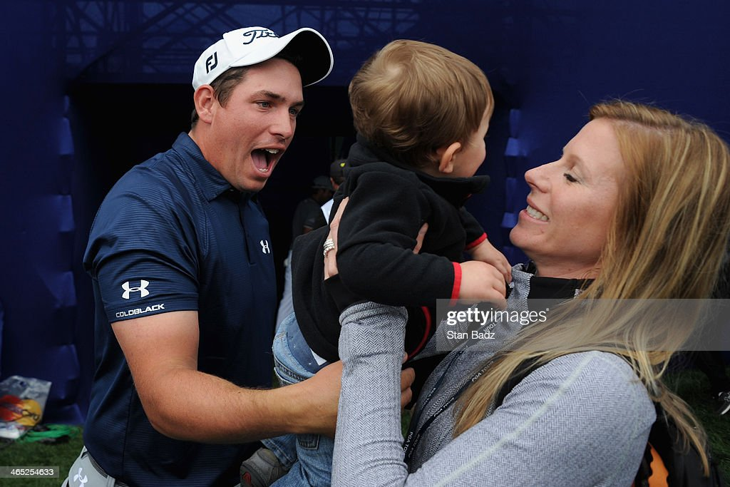Scott Stallings meets his wife Jennifer and his son Finn on the 18th hole after winning the Farmers Insurance Open on Torrey Pines South on January...