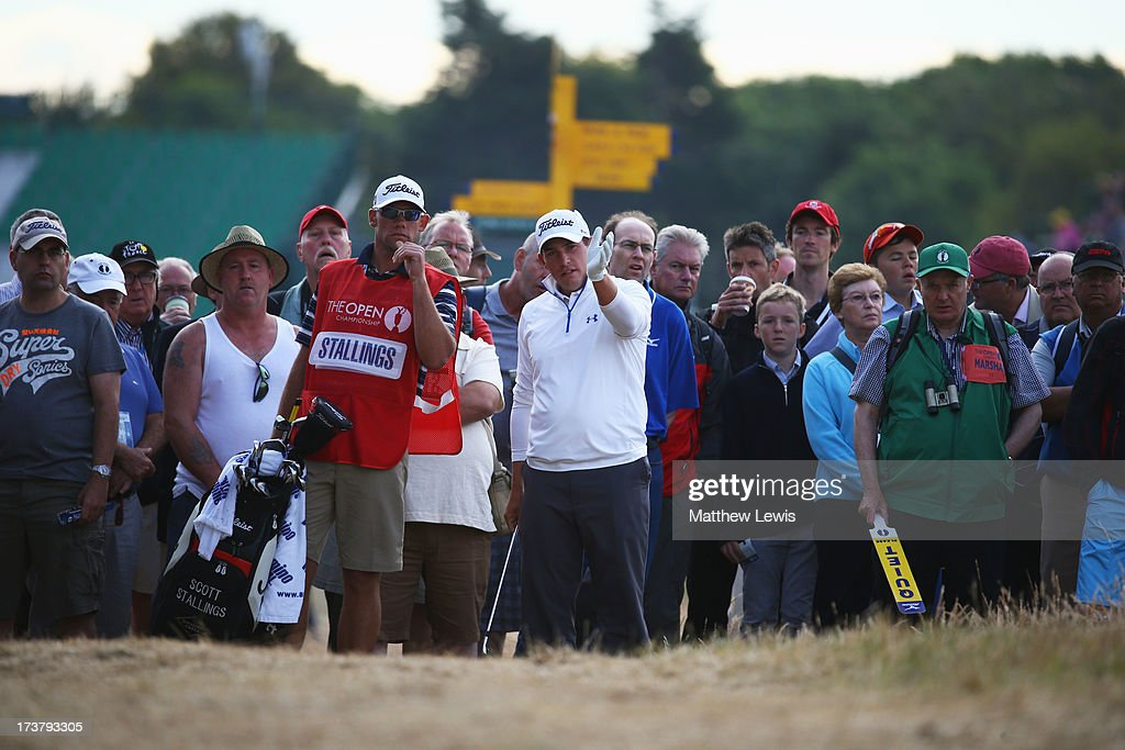 Scott Stallings of the United States makes a drop on the 1st during the first round of the 142nd Open Championship at Muirfield on July 18, 2013 in Gullane, Scotland.