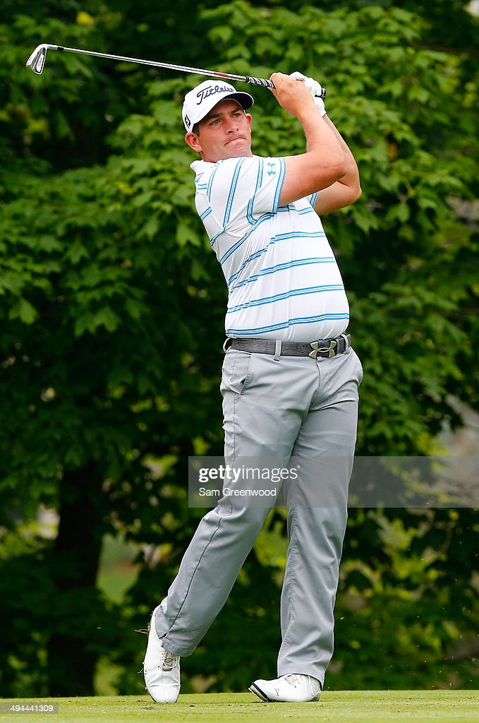 Scott Stallings plays a shot on the 14th hole during the first round of the Memorial Tournament presented by Nationwide Insurance at Muirfield...
