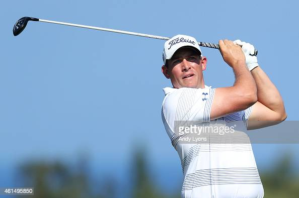 Scott Stallings plays his shot from the fourth tee during the final round of the Hyundai Tournament of Champions at Plantation Course at Kapalua Golf...