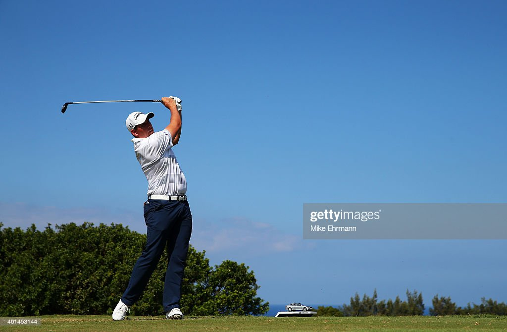 Scott Stallings plays his shot from the tenth tee during the final round of the Hyundai Tournament of Champions at Plantation Course at Kapalua Golf...