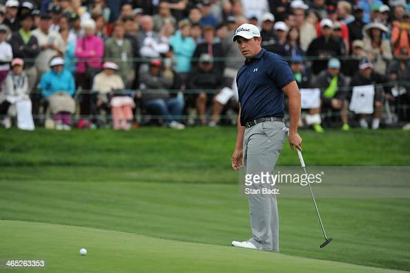 Scott Stallings putts on the 18th green during the final round of the Farmers Insurance Open on Torrey Pines South on January 26 2014 in La Jolla...