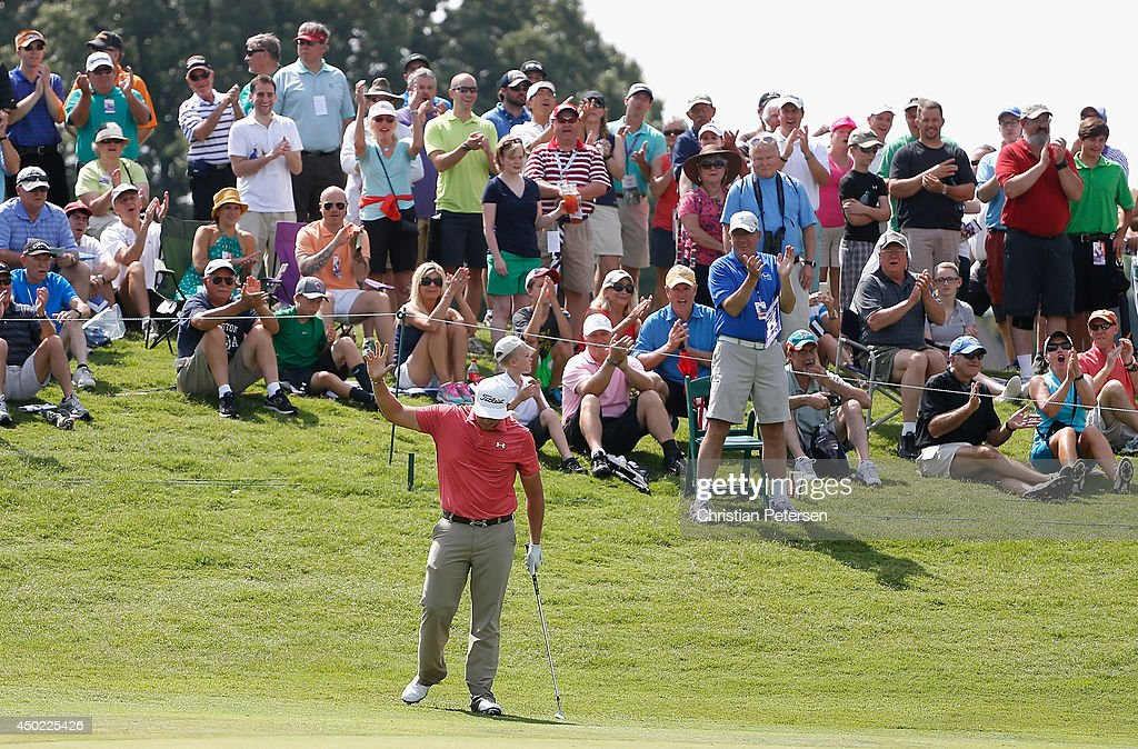 Scott Stallings reacts to fans after chipping in for birdie on the ninth green during the continuation of the second round of the FedEx St. Jude Classic at the TPC Southwind on June 7, 2014 in Memphis, Tennessee.