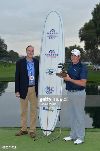 Scott Stallings right stands with Jeff Dailey CEO of Farmers Group Inc after winning the Farmers Insurance Open on Torrey Pines South on January 26...