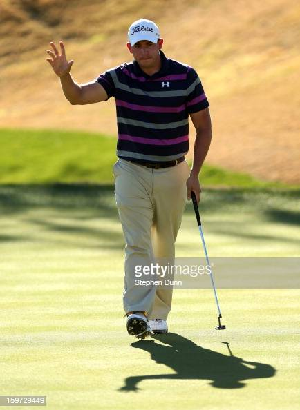 Scott Stallings waves after making an eagle putt on the eighth hole during the third round of the Humana Challenge In Partnership With The Clinton...