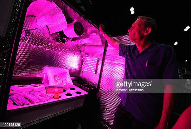 Scott Stansfield a homeopathic doctor from San Bernardino California looks over a hydroponic grow cabinet during the HempCon 2011 Medical Marijuana...