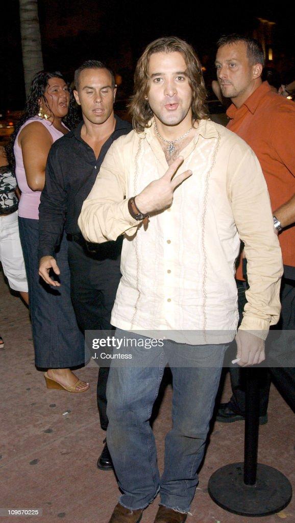 Scott Stapp (center, brown shirt) enters the RokBar