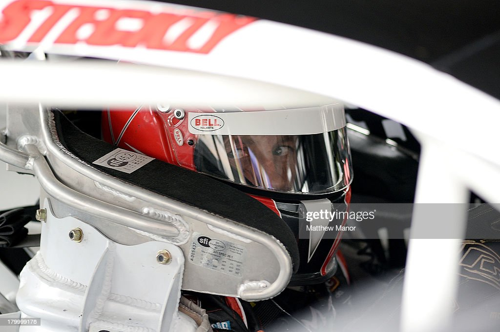 Scott Steckly, driver of the #22 Canadian Tire Dodge, waits in his car in the garage area during practice prior to the NASCAR Canadian Tire Series race at Barrie Speedway on September 7, 2013 in Oro Station, Ontario, Canada.