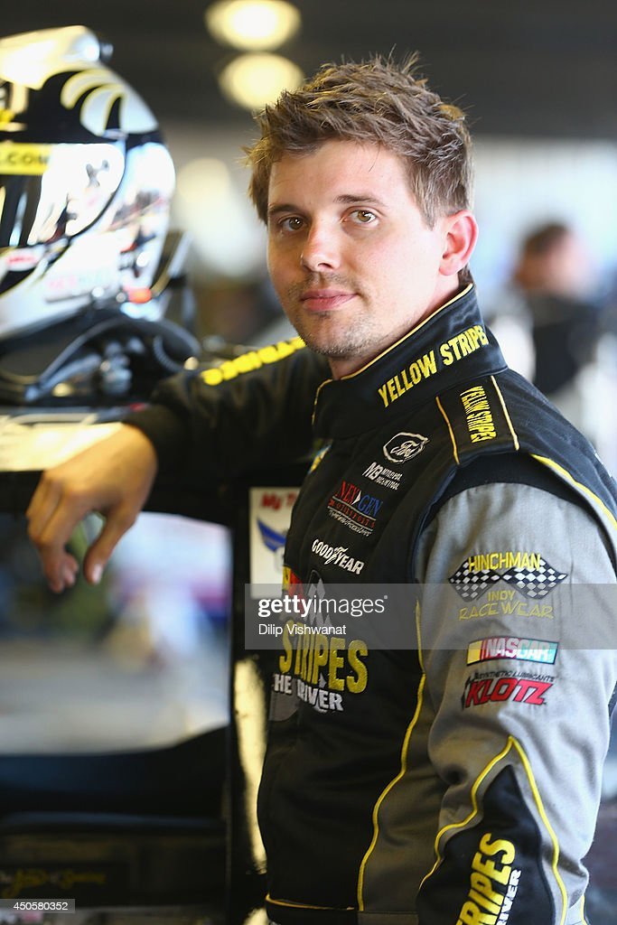 Scott Stenzel, driver of the #36 Mittler Bros Machine & Tool RAM waits in the garage during practice for the NASCAR Camping World Truck Series Drivin' for Linemen 200 at Gateway Motorsports Park on June 13, 2014 in Madison, Illinois.