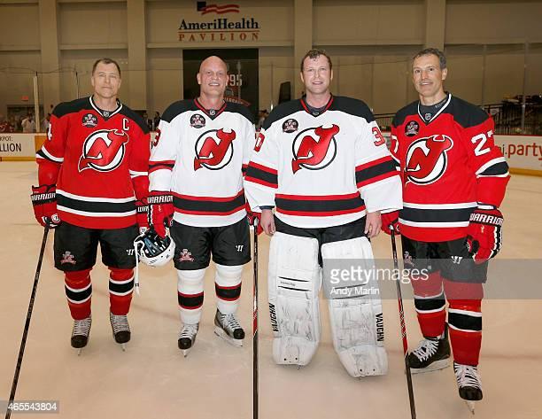 Scott Stevens Ken Daneyko Martin Brodeur and Scott Niedermayer of the New Jersey Devils 1995 Stanley Cup Championship Team pose for a photo during...