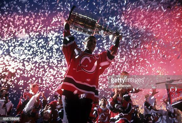 Scott Stevens of the New Jersey Devils carries the Stanley Cup Trophy during the Devils rally after winning the Stanley Cup on June 12 2000 in East...