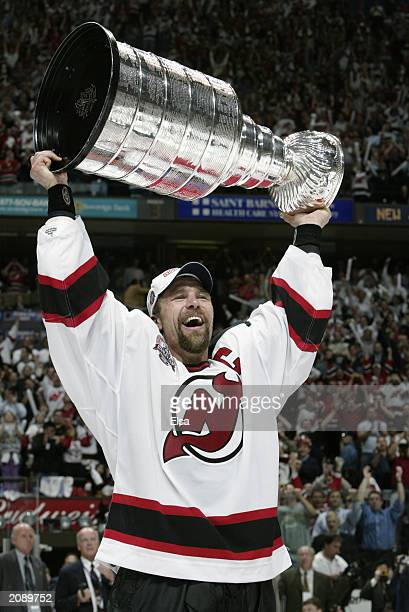 Scott Stevens of the New Jersey Devils holds up the Stanley Cup after defeating the Mighty Ducks of Anaheim 30 in game seven of the 2003 Stanley Cup...
