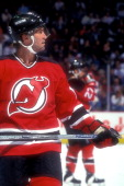 Scott Stevens of the New Jersey Devils looks on during a hockey game against the Washington Capitals on April 12 1995 at USAir Arena in Landover...