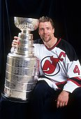 Scott Stevens of the New Jersey Devils poses with the Stanley Cup Trophy after Game 4 of the 1995 Stanley Cup Finals against the Detroit Red Wings on...