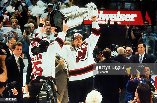 Scott Stevens of the New Jersey Devils raises the Stanley Cup after the Devils defeated the Detroit Red Wings in Game 4 of the 1995 Stanley Cup...